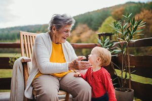 Elderly woman sitting with a toddler