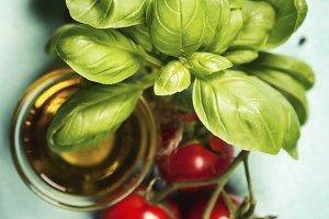 Tasty tomatoes with fresh basil leav