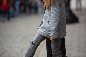 Photo of girl in gray coat standing