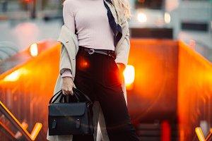 Image of full-length blonde in coat