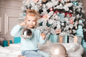 Girl with Christmas ball