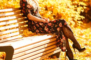 Photo of blonde sitting on wooden