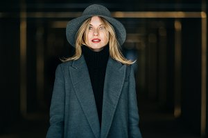 Photo of blonde in gray coat and hat