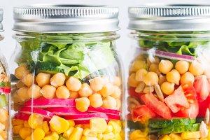 Jars with layering vegan salad