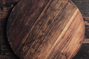 Wooden cutting board on rustic backg