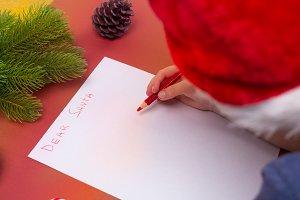 Christmas concept. Boy writing