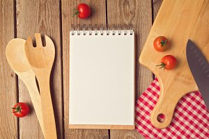 Blank notebook with cooking utensils