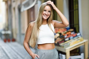 Beautiful young blonde woman smiling