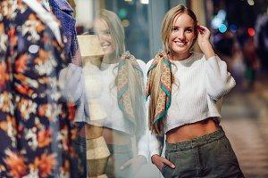 Blonde girl smiling with defocused u