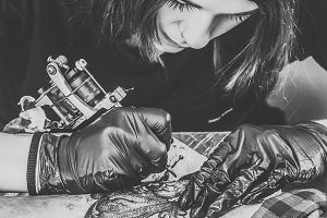Black and white photo of woman tatto