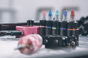 Tattoo machine and bottles with colo