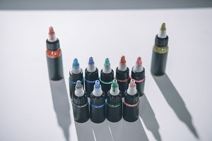 Composition of bottles with colorful