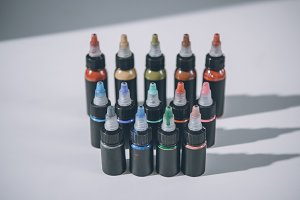 Bottles with colorful tattoo ink in