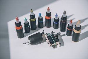 Bottles with colorful tattoo ink and