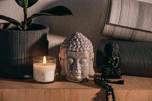 sculptures of buddha and yoga mats o