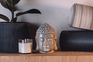 sculpture of buddha head, burning ca