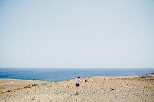 Girl Relaxing above the Ocean