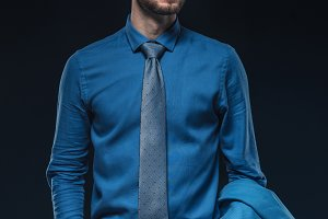 Confident man wearing blue shirt and