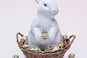 ester bunny with quail eggs and stra