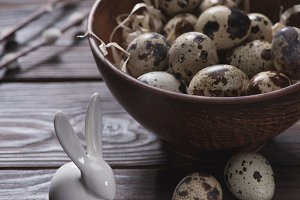 easter quail eggs in bowl with straw