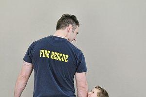 """Admiration"" Fireman with Boy"
