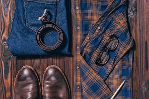 flat lay with male shirt, shoes, jea