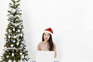 Christmas tree with woman laptop