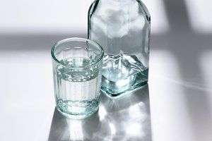 close up view of glass and bottle wi