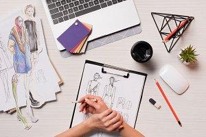 office desk with laptop, art supplie