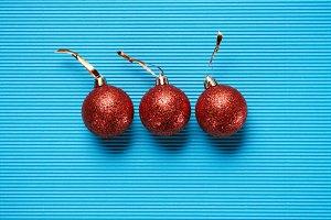 Flat lay of three red shiny decorati
