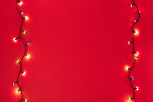 Two glowing garlands on red backgrou