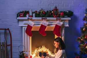 beautiful woman holding gift and sit
