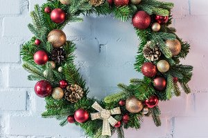 Christmas wreath hanging on white br