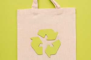 Tissue bag with recycle sign on yell
