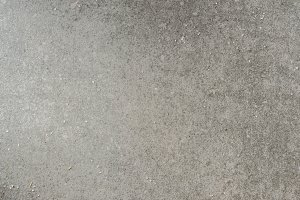 Grey textured granite surface with s