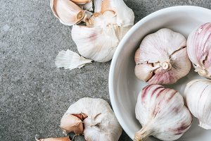 Top view of garlic in ceramic bowl a