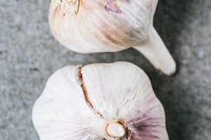 close up of two ripe garlic bulbs on