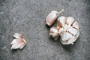top view of peeled ripe garlic bulb