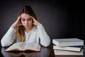 young woman concentrated in reading