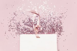 Flat lay White gift bag confetti