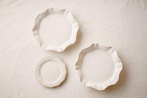 Porcelain plates on linen tablecloth