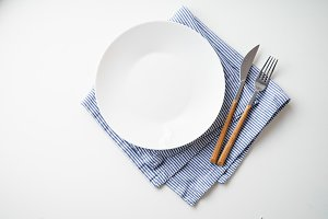 White empty plate with knife and for