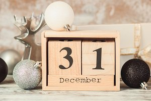 Hand changing wooden calendar with d