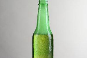Single Bottle of Beer With Foam