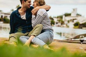 Couple sitting outdoors near a lake