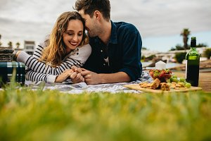 Romantic couple out on picnic lying