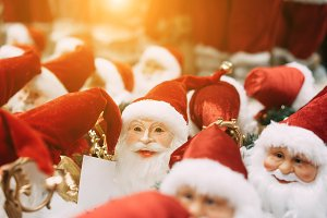 Several small toy Santa Clauses stan