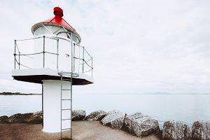 White lighthouse Norway landscape