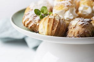 Delicious profiteroles with cream