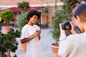 Young blogger with photographer
